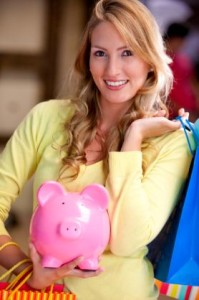 Shopping woman saving money in a piggy bank