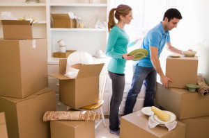 couple-unpacking-surrounded-by-boxes
